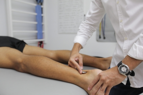 Myofascial Release Therapy & Trigger Point Therapy myofascial release performed on a persons calf